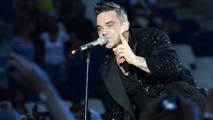 Robbie Williams performing during a solo concert