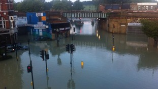 Cars and traffic lights left under water