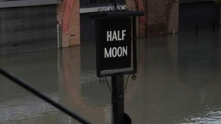 Submerged pub sign