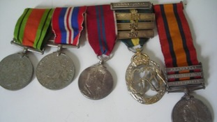 Five medals found by the roadside in Bacton