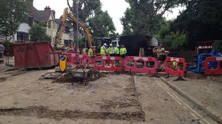 Engineers work on the pipework in Herne Hill after a water main burst yesterday