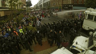 Police clash with loyalist protestors in Belfast.