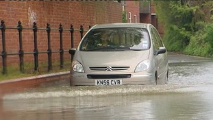 A car takes on the floods earlier today