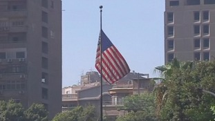 The US flag flies over its embassy in Cairo as it reopens following security concerns.