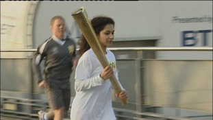 Girl running with Olympic torch