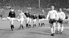 The two team walk out onto the pitch at Wembley Stadium in 1967. Scotland would go on to beat the World Champions 3-2.