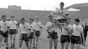 England's captain Johnny Haynes is held aloft by his team-mates after their emphatic win against Scotland