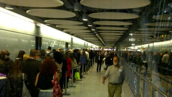 Passengers queue at Heathrow Airport