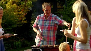 man serves meat at barbecue