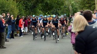 Bradley Wiggins and Team Sky leads a group of cyclists through the Peak District
