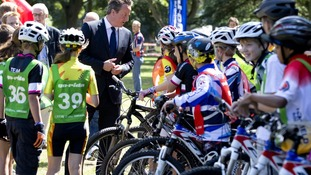 David Cameron speaks to children involved in a 'Go Ride' cycling event in Watford