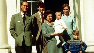 Queen Elizabeth II holding Prince Edward with by her family the Duke of Edinburgh, the Prince of Wales and Princess Anne, at Windsor