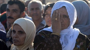 Palestinian families wait to receive the news of whether their loved ones will be freed