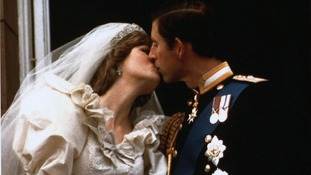 Prince Charles kisses his new bride Diana on their wedding day July 29, 1981