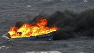 The speedboat set alight after the drugs and suspected smugglers were detained