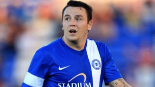Lee Tomlin has seen a transfer request turned down by Peterborough United