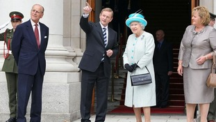 The Queen listens to Ireland's PM Enda Kenny watched by Prince Philip and Kenny's wife Fionnuala