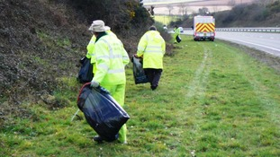 council workers picking rubbish from verge