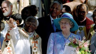 Queen Elizabeth II leaving St Georges Cathedral, accompanied by Archbishop Desmond Tutu  and President Nelson Mandela