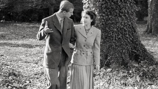 Princess Elizabeth and The Duke of Edinburgh walking in the grounds of Broadlands on their honeymoon
