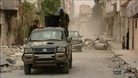 Pro-Assad forces patrol Syria's third largest city of Homs