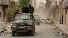 Pro-Assad forces patrol Syria's third largest city of Homs