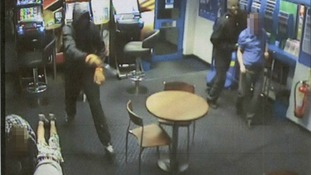 CCTV image of an armed robbery at Coral bookmakers, High Street, Chesterton, Cambridge.