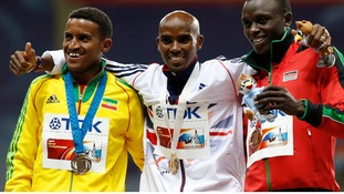 Mo Farah poses with silver medallist Hagos Gebrhiwet of Ethiopia and bronze medallist Isiah Kiplangat Koech of Kenya.
