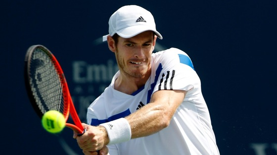 Andy Murray hits a return ball to Czech player Tomas Berdych.