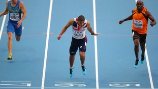 Adam Gemili dips on the line to win his 200 metre semi final