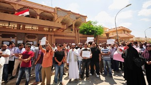 Supporters of the ousted president Mohamed Morsi outside the Egyptian consulate in Beghazi on Thursday