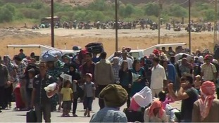 Thousands of Syrian refugees have poured into the Kurdistan region of northern Iraq.
