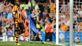 Chelsea's Emboaba Oscar celebrates scoring the opening goal of the game during the Barclays Premier League match at Stamford Bridge