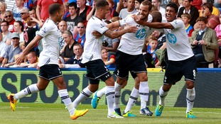 Tottenham Hotspur's Roberto Soldado celebrates with his team-mates after scoring his side's first goal