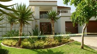Police tape outside Oscar Pistorius' upmarket home where Reeva died