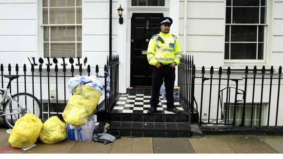 Police guard Gareth Williams' Pimlico flat in London.
