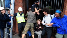 Police clash with anti-fracking protesters at Cuadrilla Resources' headquarters in Lichfield.