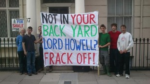 Protesters outside a building said to be the home of Lord Howell