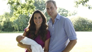 Prince George is held by his mother the Duchess of Cambridge.