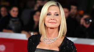 A man has been found dead from a gunshot wound inside a Florida home owned by singer Olivia Newton-John.