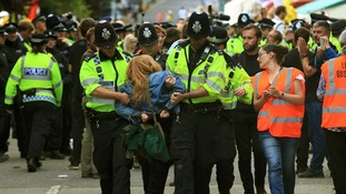 Police carry an anti-fracking activist away from the demonstration in Balcombe