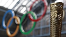 The Olympic torch and Olympic rings.
