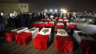 The coffins of 25 police officers killed yesterday morning near the north Sinai village of Rafah.