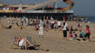 People enjoy the sun at Great Yarmouth beach in Norfolk.