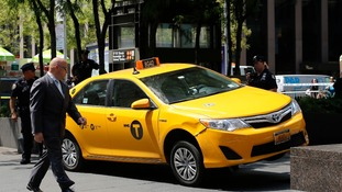 The taxi swerved outside the Rockefeller Center in Manhattan.
