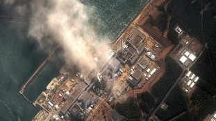 The Fukushima Daiichi nuclear plant is seen burning after it was destroyed by an earthquake and tsunami in March 2011