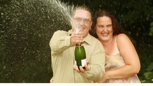 Tracy Tyler, 37 and partner Adam Young, 30 from Epping who have won £5.819.806 with a lucky dip ticket on the National Lottery