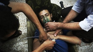 A man, allegedly affected by nerve gas, uses an oxygen mask to breathe in the Damascus suburbs of Jesreen