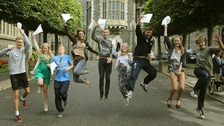 Students at Brighton College in East Sussex, celebrate their GCSE results.