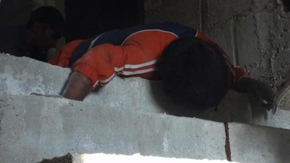 ศพของเด็กชายในที่เกิดเหตุ